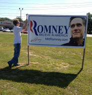 Me putting up some full color Romney signs I donated.